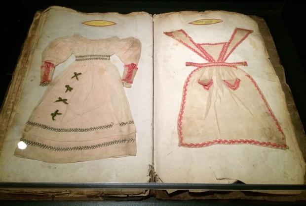 A book of dress patterns.