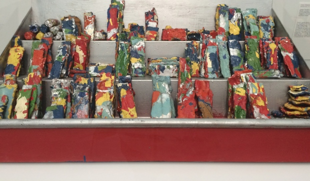 Claes Oldenburg, Candy Counter with Candy, 1961, plaster painted with enamel in a painted steel and wood case
