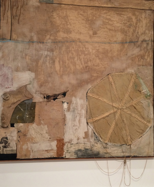 Robert Rauschenberg, Untitled, about 1955, combine painting: oil, house paint, paper, fabric, and printed reproductions, with sock and parachute on canvas