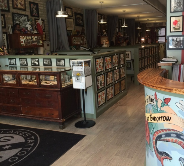 While visiting the gallery don't miss the tattoo shop itself. A welcoming atmosphere invites you to enjoy art along the wall and encased tattoo memorabilia.